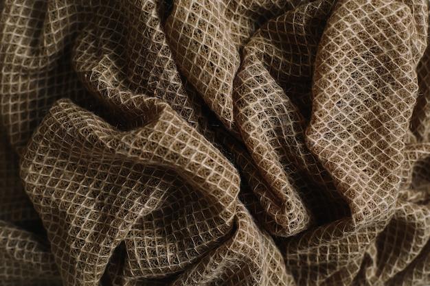 Морщинистый мятой вязаный узор текстуры