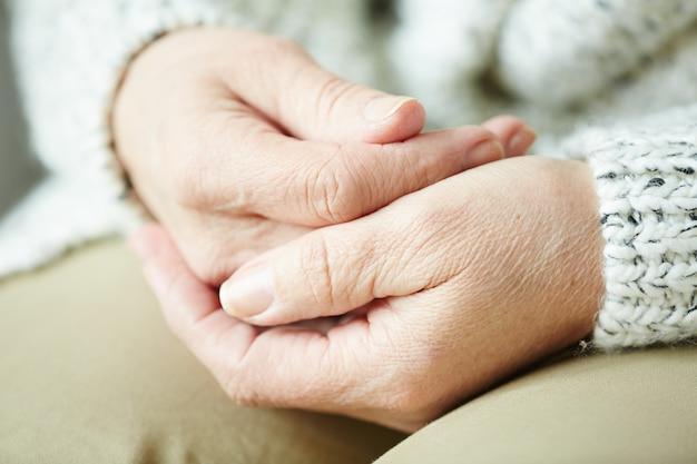 Wrinkled female hands