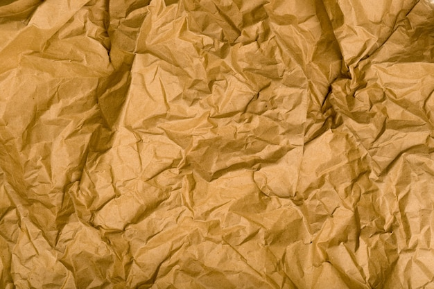 Морщинистая текстура бумаги крафт. естественный коричневый старинный фон