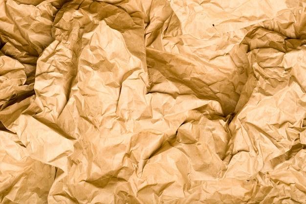 Морщинистая текстура бумаги крафт. естественный коричневый винтажный космос