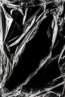 Wrinkled plastic wrap texture on a black background