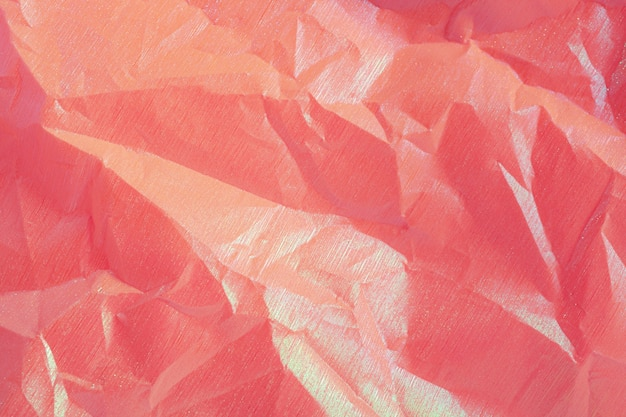 Wrinkled purple pink holographic crumpled paper abstract background