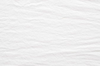 Wrinkled white cotton fabric textured background