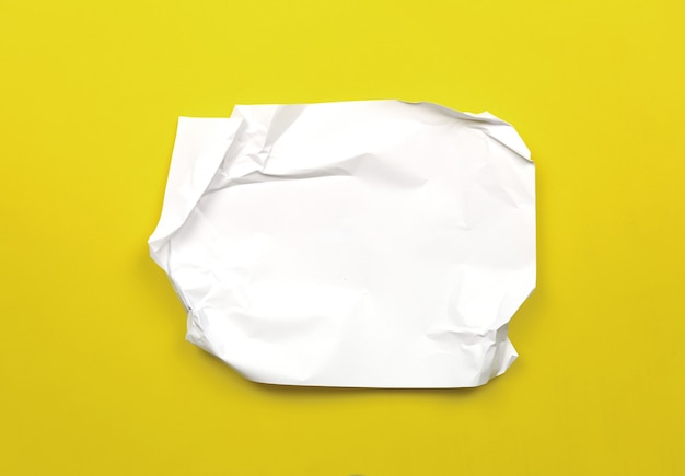 Wrinkled white paper on yellow art paper