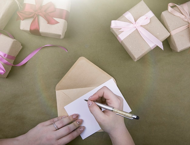 Write in a notebook on the background of gifts