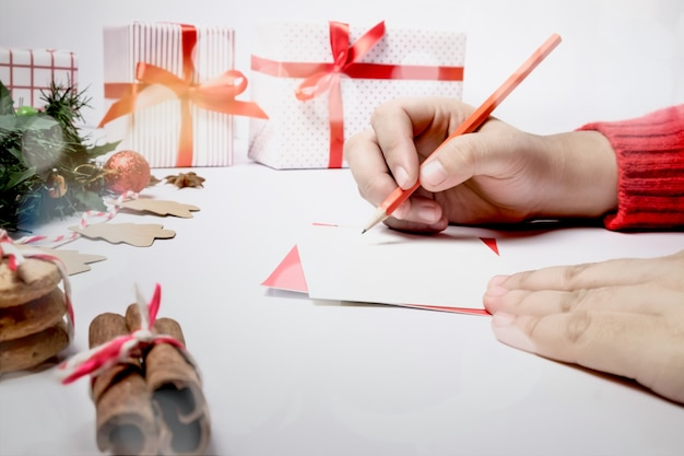 Write wishing on the greeting card and chrsitmas card.