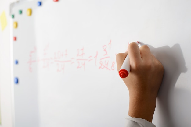 Writing math exercises on a board