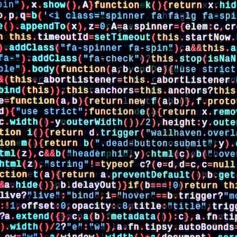 Writing programming code on laptop.