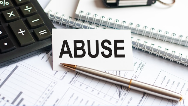 Writing text abuse on white paper card