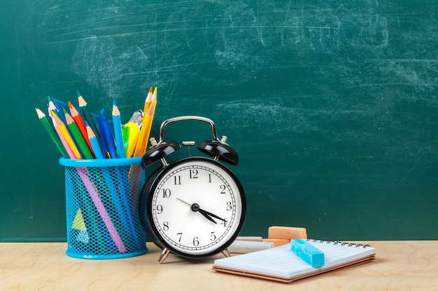 Writing utensils and alarm clock