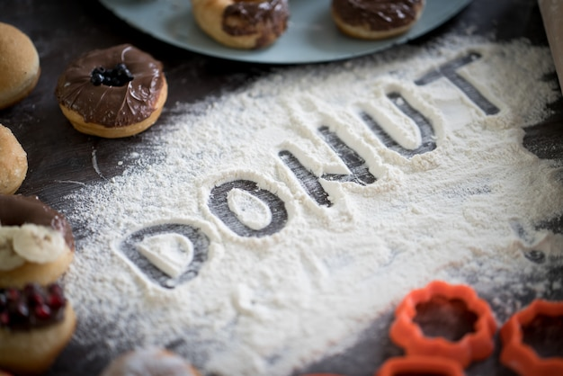 Written letters of dough ready for donut
