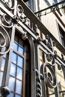 Wrought iron fence on house facade