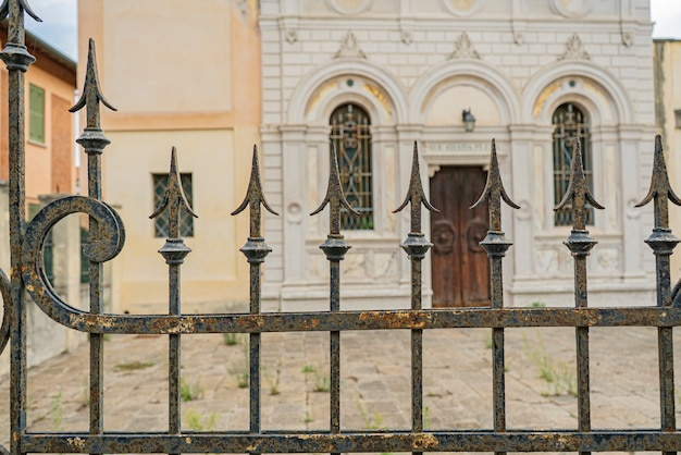 Wrought iron gate spikes detail in an ancient building in italy