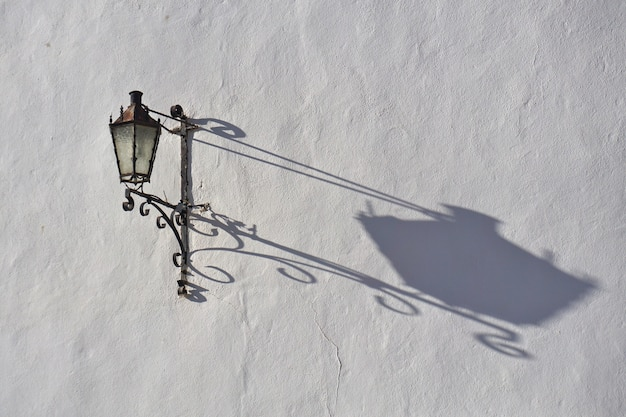 Wrought iron street lantern in the old town, ronda, malaga province, andalucia, spain.