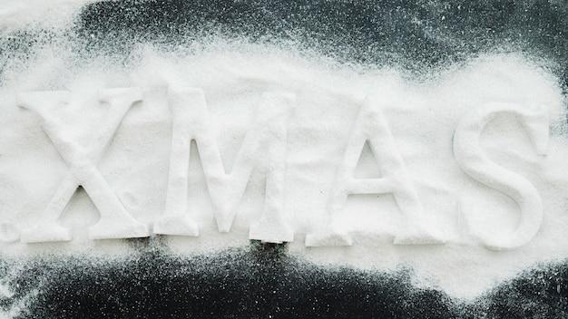 Xmas inscription between decorative snow