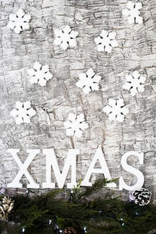 Xmas inscription with small snowflakes