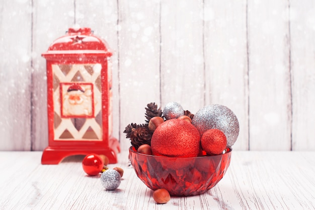 Xmas or new year card with lantern, cones, nuts