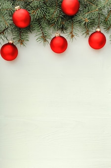 Xmas new year  holiday celebration pattern composition made of red balls fir branches on white