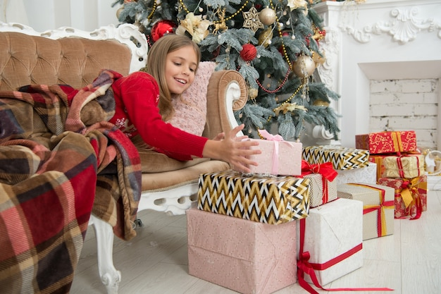 Xmas online shopping. christmas is the time to please. family holiday. happy new year. winter. the morning before xmas. little girl. christmas tree and presents. child enjoy the holiday.