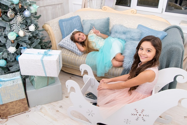 Xmas online shopping. this is for you. family holiday. christmas tree and presents. happy new year. winter. the morning before xmas. little girls. child enjoy the holiday.
