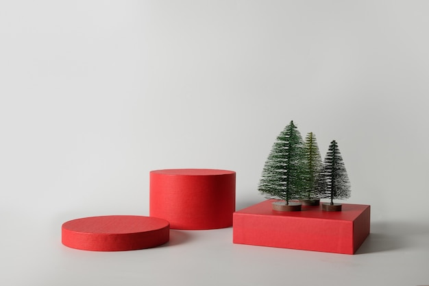Xmas red stands with decorative christmas tree for product.