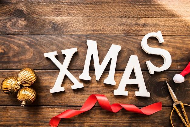 Xmas title near scissors and ornament balls