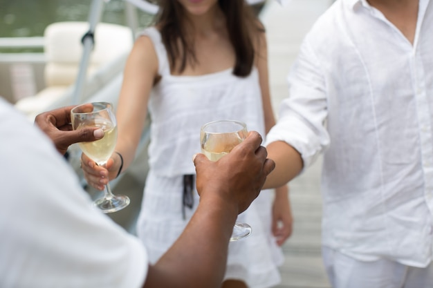 Yacht captain treats his guests to a glass of champagne