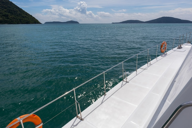 Yacht cruise on sunny day at ao chalong phuket, thailand