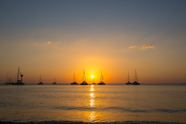 Yacht in the sea during sunset