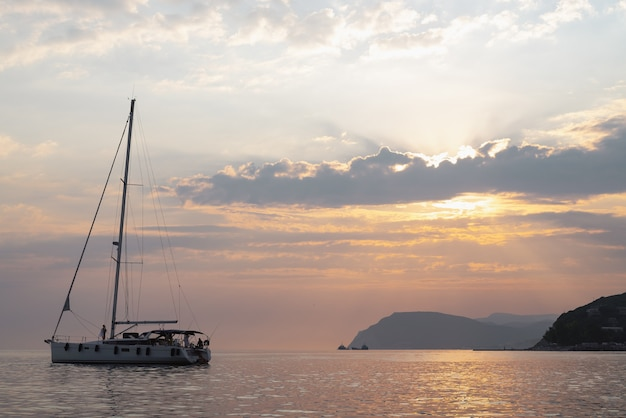 Yacht at sea at sunset yachting luxury sailing theme family holiday
