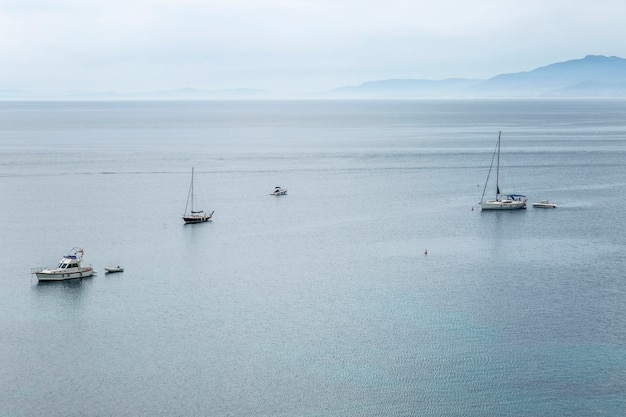 Yachts in the sea, view from above. blue haze, beautiful landscape.