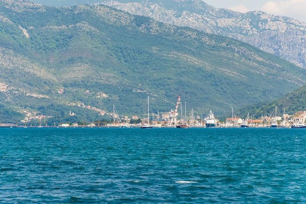 Yachts of various sizes and large vessels moored in the port of tivat. Premium Photo