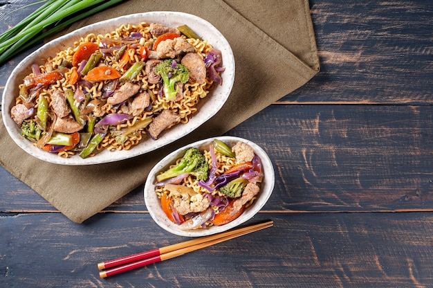 Yakisoba, famous japanese fried noodles, with meat and vegetables. top view.
