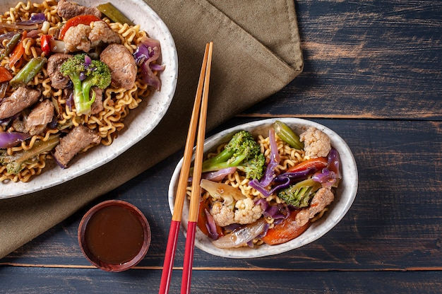 Yakisoba, famous japanese fried noodles, with meat and vegetables. top view