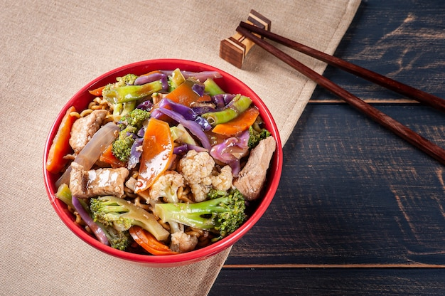 Yakisoba, famous japanese fried noodles, with meat and vegetables.