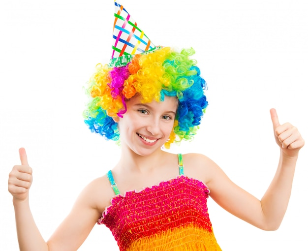 Yappy girl in clown wig shows thumbs up isolated