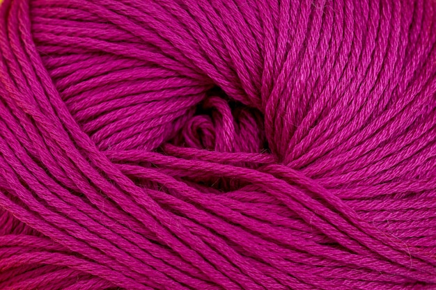 Yarn for knitting close-up background. magenta, pink
