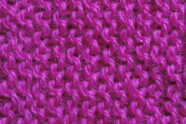赤の毛糸テクスチャのクローズアップ。