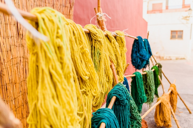 Yarns of colored wool freshly dyed by arab craftsmen drying in the sun.