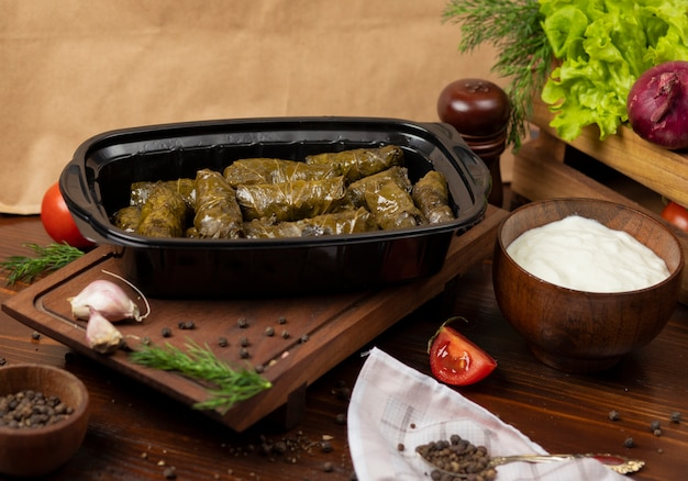 Yarpaq dolmasi, yaprak sarmasi, green grape leaves stuffed with meat takeaway