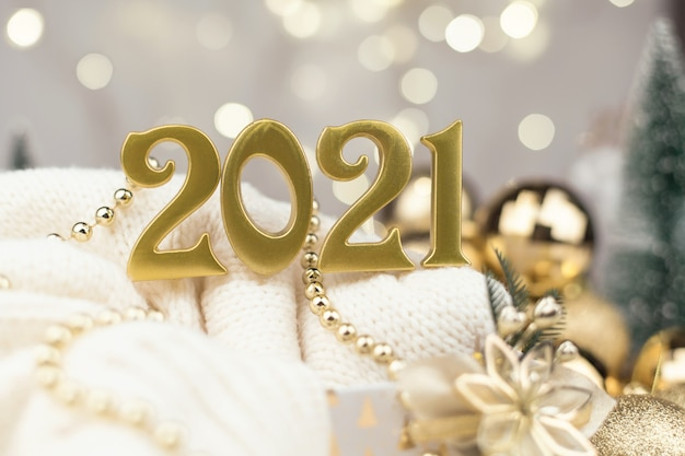 Year 2021 numbers on golden bokeh background new year mood, christmas, greeting card, new year background