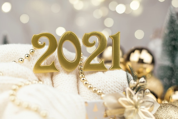 Year 2021 numbers on golden bokeh background new year,