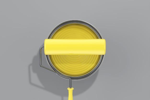 Модные цвета 2021 года. светящаяся желтая краска может вид сверху с малярным валиком на предельно сером фоне. 3d рендеринг