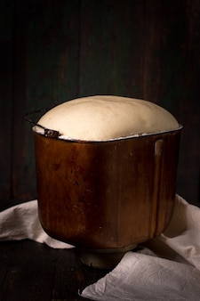 Yeast dough rises in the bowl