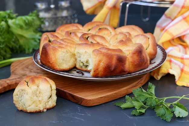 Yeast pie with herbs and garlic