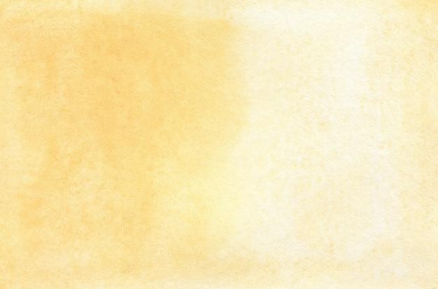 テクスチャードペーパーの黄色の抽象的な水彩画の背景