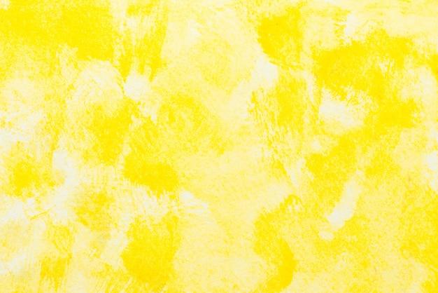 白い紙の背景に黄色の抽象的な水彩画のテクスチャ