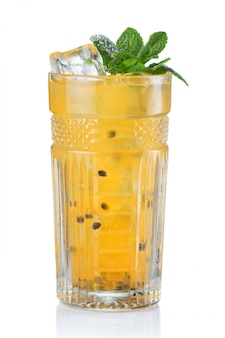 Yellow alcohol cocktail with passionfruit isolated