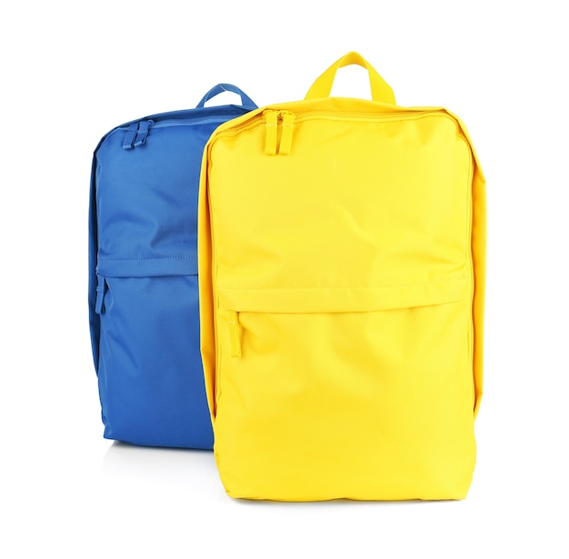 分離された黄色と青のバックパック