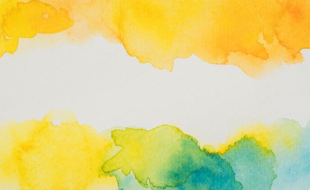 黄色と青の水彩の汚れ